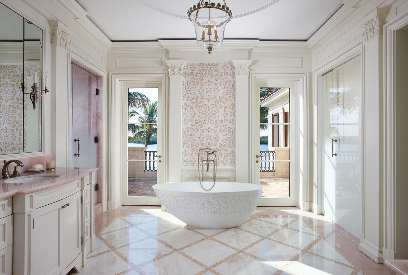 Rose onyx and white marble details in a quintessentially feminine bath