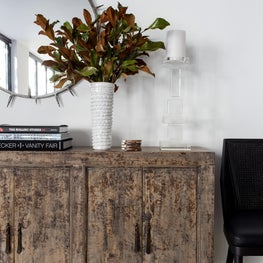 Modern foyer with spike-detail mirror, rustic console cabinet