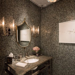 An eclectic globe fixture illuminates the gray powder room.