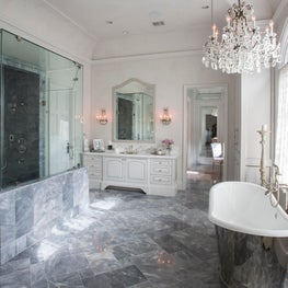 Luxurious master bath with a free standing tub & custom tile work