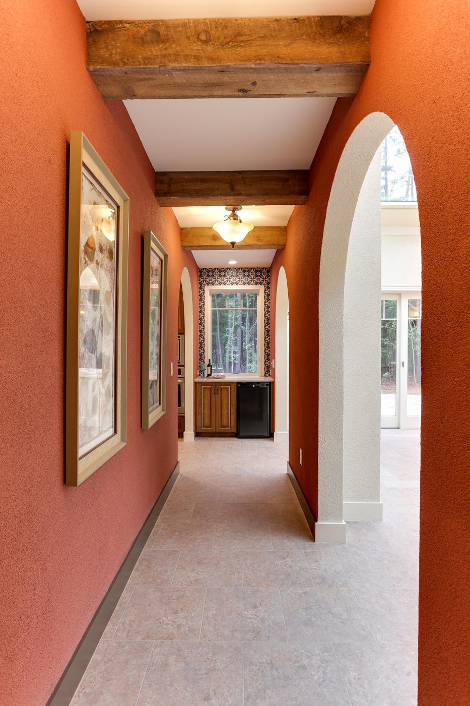 Spanish Hacienda style stucco walls, reclaimed wood beams, and colorful tile.