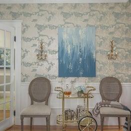 Elegant toile wallpaper sconces bar cart cane chairs molding trim french door