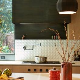 Modern Kitchen, Custom Steel hood, texture backsplash & integrated cooktop knobs