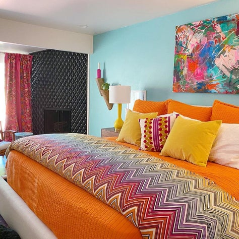 Bedroom with fall colors and bold bedding