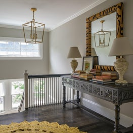 Foyer with Tiger Stripe Mirror, Antique Console Table and Round Jute Rug