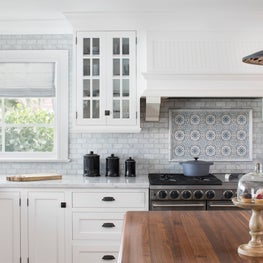 Farmhouse Coastal Kitchen with hand painted carrara marble backsplash