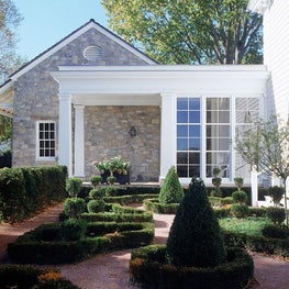 American Colonial house with a small classical garden.