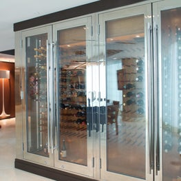 Custom hi- polish wine cabinet- Miami waterfront penthouse. Leather paneling.