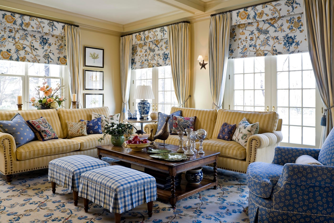 A fun play on modern and traditional design comes together in this textile-rich family room.