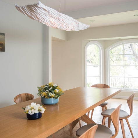 Natural light washes the dining room in a warm glow.