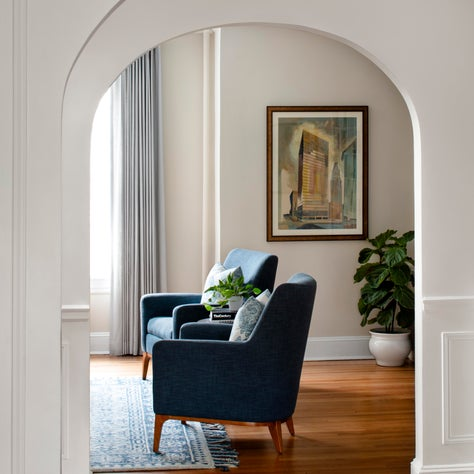 Ridgedale, A Modern Living Room with Arched Doorways and Modern Armchairs