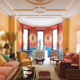 A glamorous New York City townhouse is invigorated with bold color and murals.