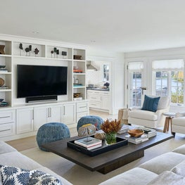 Family Room, Neutral Palette, Blue Hues, Built-In Shelving, Poufs, Blue Pillows — Pine Lake Project