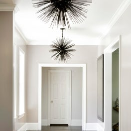 hallway with statement lighting