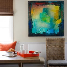 Kitchen seating area with banquette and commissioned artwork
