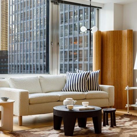 Mies : Mid Century Sofa, Tribal Rug, Bamboo Screen, Noguchi Lamp, Marble Side Table