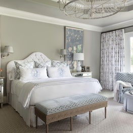 Master bedroom in soft blue palette with custom bedding & monogram finish