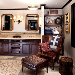 TRADITIONAL BACHELOR APARTMENT IN HISTORIC SCHOOL The client insisted that the master bath be functional AND a great place for him to sit back and watch tv.  We used a mix of honed and polished marble, mosaics and rich wood tones, and installed rich leath