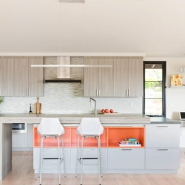 2018 ASID Ca Peninsula Platinum, Judges Choice Award  An outdated and dark kitchen is relocated and updated to a sleek modern kitchen which takes advantage of the view and opens with bi-fold and sliding doors to access the deck for entertaining.