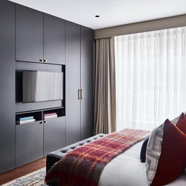 Lofty Ambitions - Master bedroom; masculine and sophisticated