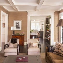 Classic Family Room with Grasscloth Walls, Coffered Ceiling and Art Deco Chairs