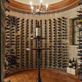 Cable Wine Racks Exposing Stone Walls in Spherical Wine Cellar - Minnesota