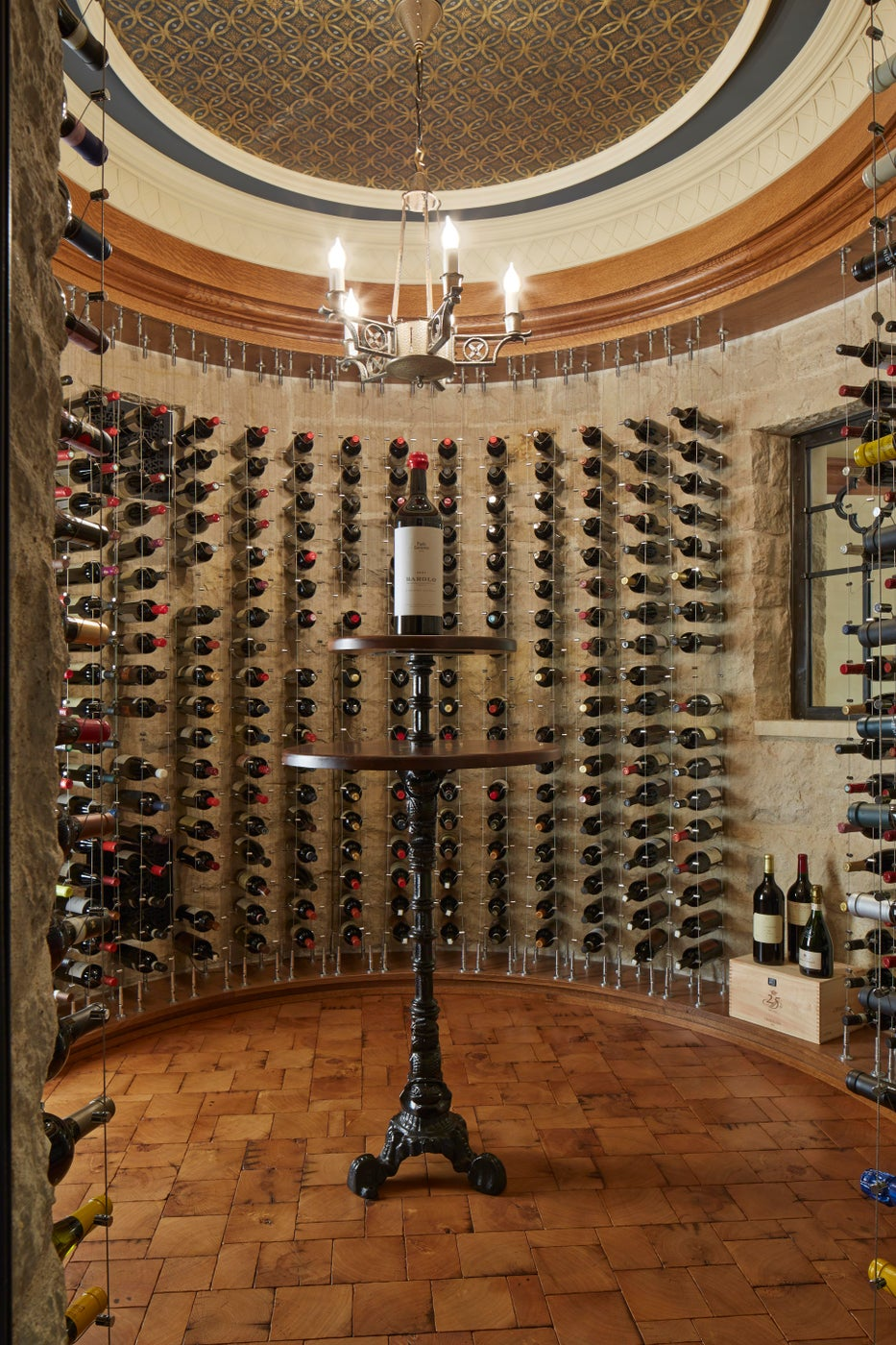 Cable Wine Racks Exposing Stone Walls in Spherical Wine Cellar - Minnesota