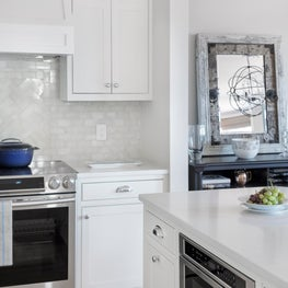 """White and bright kitchen with a """"hidden"""" microwave drawer for convienence"""
