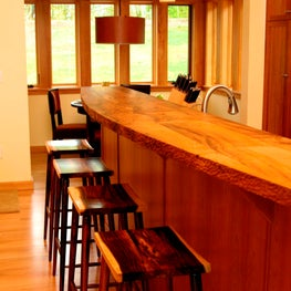 NW hills, Portland, OR: Hand-chiseled maple breakfast countertop in kitchen.