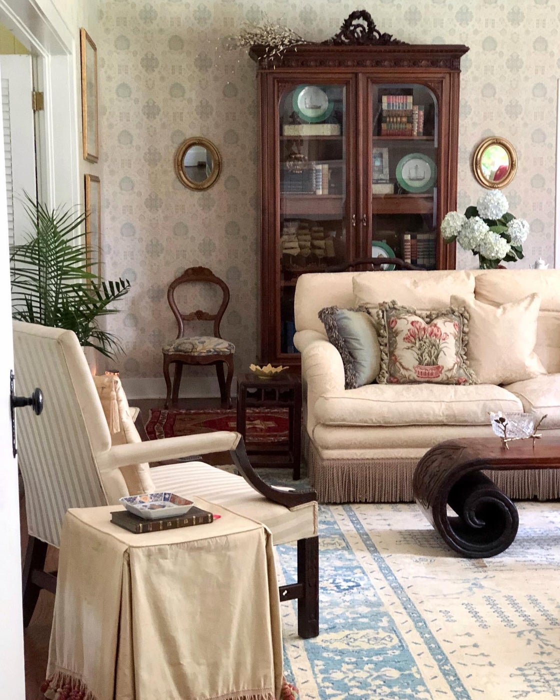 This elegant 1930's colonial cottage is overflowing with charm.  Original historic wallpapers were carefully preserved to set a pretty backdrop for antiques, family heirlooms, and personal collections.