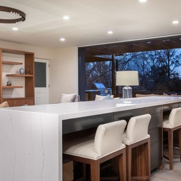 Open Plan Fusion - Custom work area stone desk bar with steel faced drawers and white leather and walnut chairs