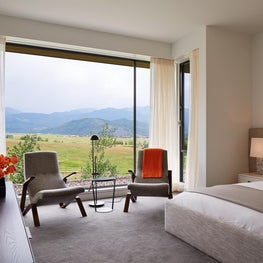 Second Floor Bedroom with floor to ceiling window to capture dramatic mountain view.