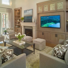 Neutral transitional Living Room with custom built-ins and clean line upholstery