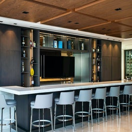 Custom wood ceilings are the fifth wall to this custom bar.