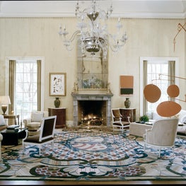 Large living room with modern art, large, colorful rug