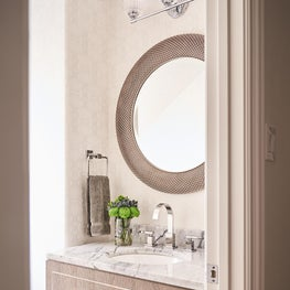 Inspiration for a mid-sized coastal wallpaper powder room remodel in Dallas with marble countertops, white countertops and a floating vanity