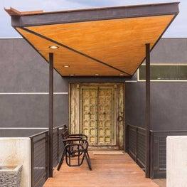 Boulder, Colorado Foothills Retreat - Home entrance with rustic antique doors
