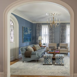 Beacon Hill Family Room with Arched Doorway and Swedish Chandelier