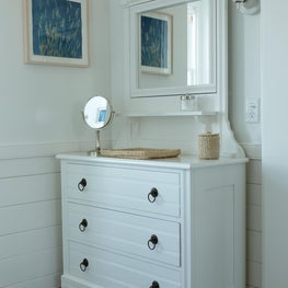 Chest of drawers in master bathroom.
