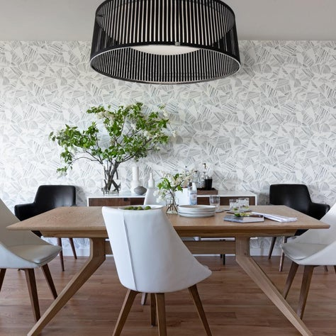 Contemporary Dining Room with Blue Wallpaper and Sculptural Pendant Light