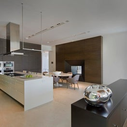The open concept kitchen brings in a wealth of natural lighting.