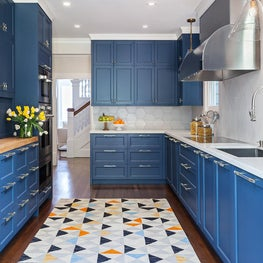 Colorful Galley Kitchen with Glass Pendants in Pacific Heights Home