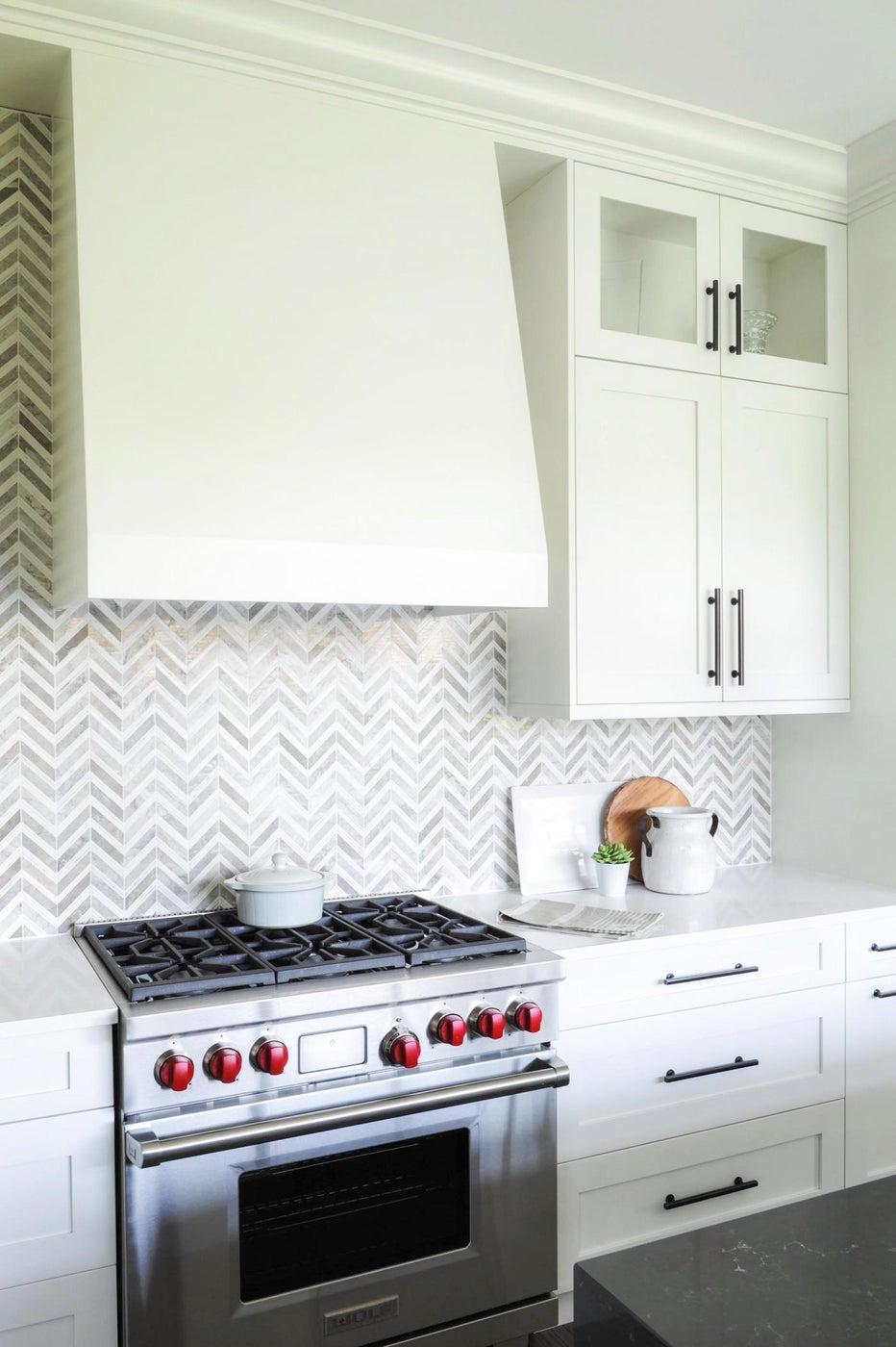 Modern kitchen with herringbone backsplash