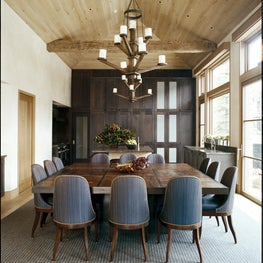 Bright dining room with rustic beams, shades of wood