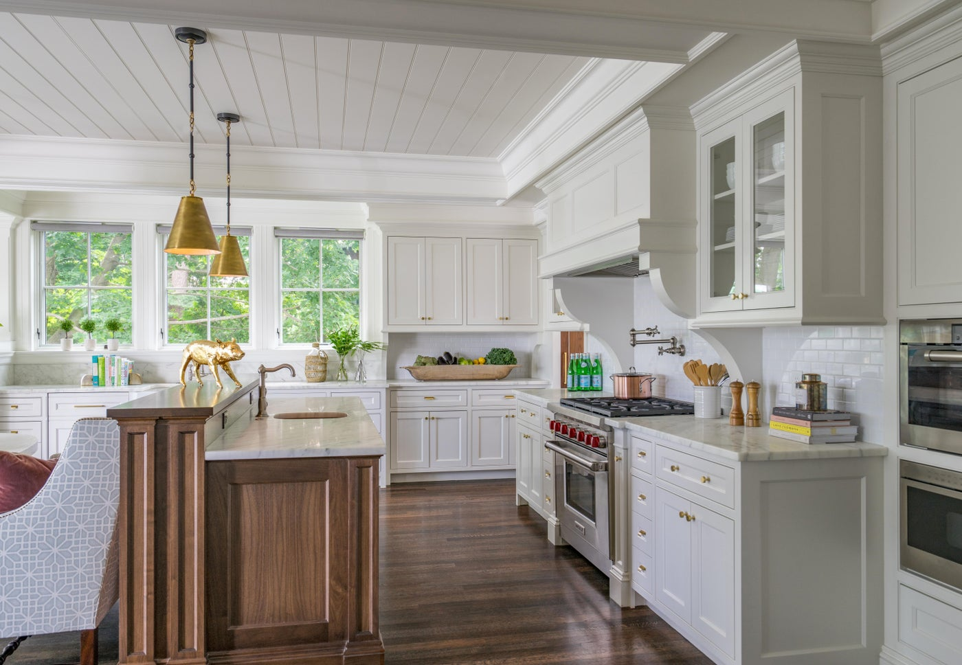 Kitchen with Subway Tile, Marble Counter Tops, Brass Hardware and Wood Flooring