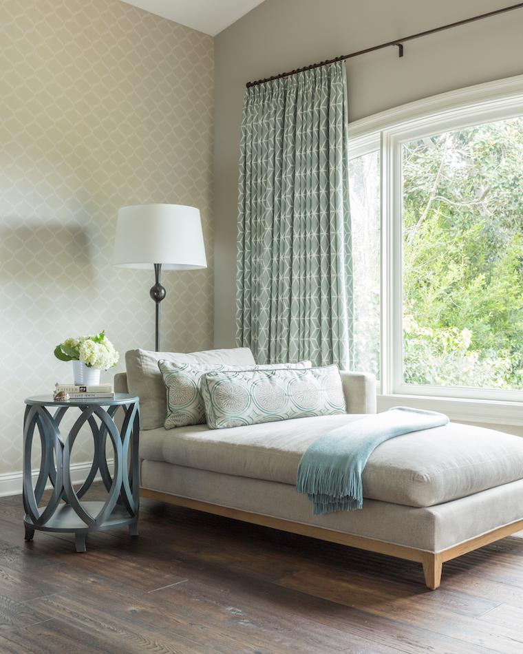 Master bedroom seating area with custom window treatments and chaise lounge
