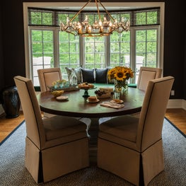 Modern meets Rustic in this cozy dining room with whimsical chandelier