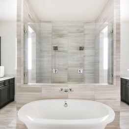 Spacious and relaxing bath with luxury tiles and fixtures.