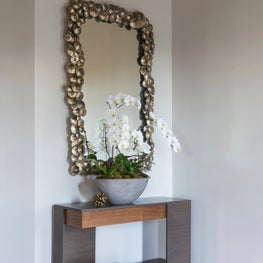 Contemporary lines of the Foyer console juxtapose the organic nature of the antiqued silvered frame mirror - Los Altos Hills Residence