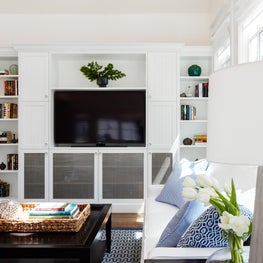 Cape Cod Living Room with White Built-Ins and Blue Accents in North San Mateo